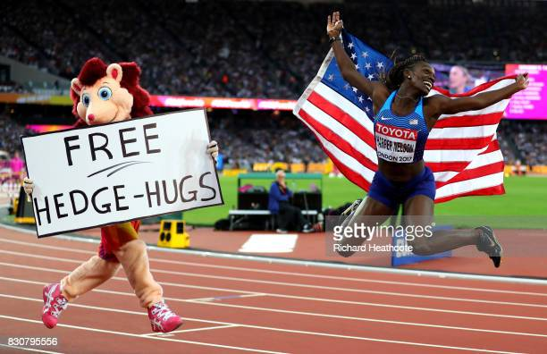Dawn Harper Nelson of the United States silver celebrates with an American flag and Hero the Hedgehog after the Women's 100 metres hurdles final...