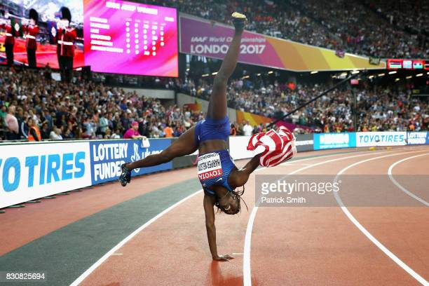 Dawn Harper Nelson of the United States silver celebrates with an American flag after the Women's 100 metres hurdles final during day nine of the...