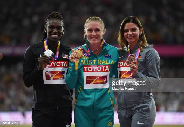 Dawn Harper Nelson of the United States silver Sally Pearson of Australia gold and Pamela Dutkiewicz of Germany bronze pose with their medals for the...