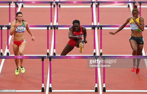 Dawn Harper of the United States leads Alina Talay of Belarus and Shermaine Williams of Jamaica in the Women's 100m Hurdles Semifinals on Day 11 of...