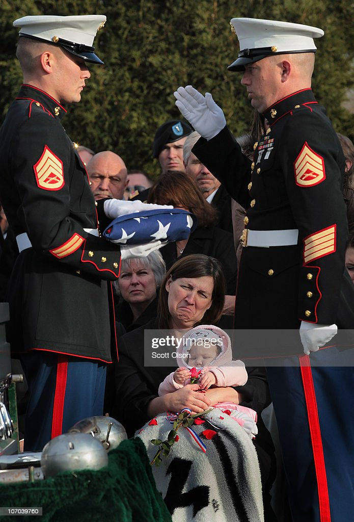 Dawn Hedrick holds her granddaughter Mikayla, during a graveside service for Mikayla's father Marine Lance Cpl. James Stack November 20, 2010 in Arlington Heights, Illinois. Stack was killed November 10 while serving with 3rd Battalion, 5th Marine Regiment in Sangin, Afghanistan.