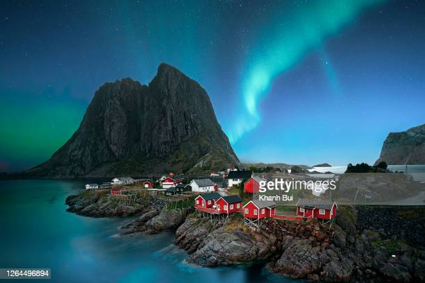dawn in small viilage, lofoten and magic northern lights in sky - norway stock pictures, royalty-free photos & images
