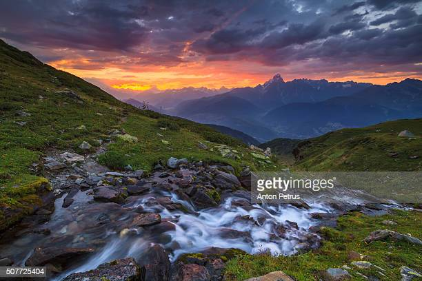 dawn in the mountains with river - anton petrus panorama of beautiful sunrise stock pictures, royalty-free photos & images