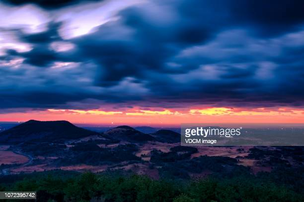 dawn in volcanic cones vd702 - jeju stock photos and pictures