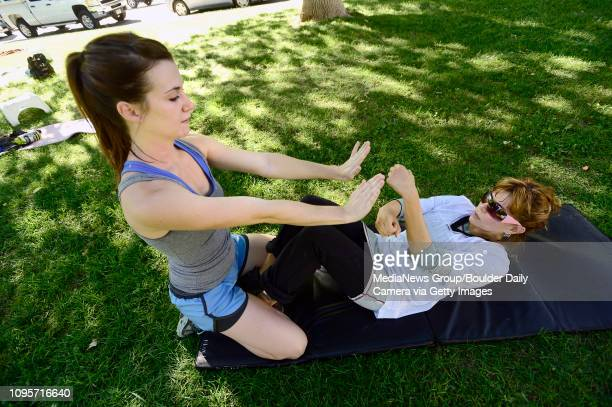 Dawn Korres punches Brooke Null's hands during a abdominal exercise in instructor Annette Bray's ski conditioning class in North Boulder Park on...