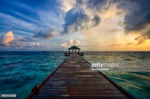 dawn light over the maldives - vilamendhoo stock photos and pictures