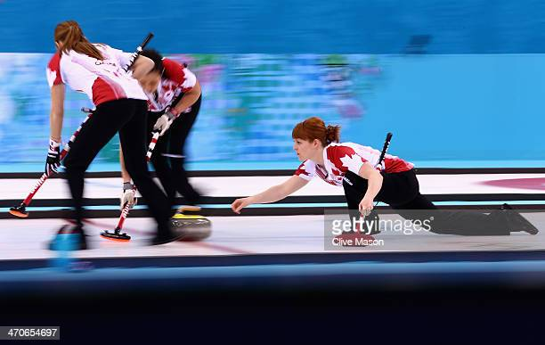 Dawn McEwen of Canada places a stone during the Gold medal match between Sweden and Canada on day 13 of the Sochi 2014 Winter Olympics at Ice Cube...