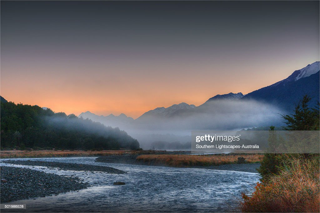 Dawn mist rising from the Eglinton Valley, south island, New Zealand. : Stock Photo