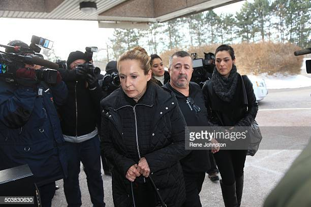 Dawn Muzzo L and his Fiancee r with unidentified man in middle arrive at Newmarket Courthouse for court appearance by her son Marco Muzzo who was...