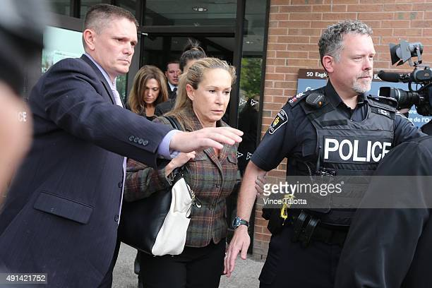 Dawn Muzzo leaves Newmarket Courthouse after a brief court appearance by her son Marco Muzzo who was charged with impaired driving causing death and...