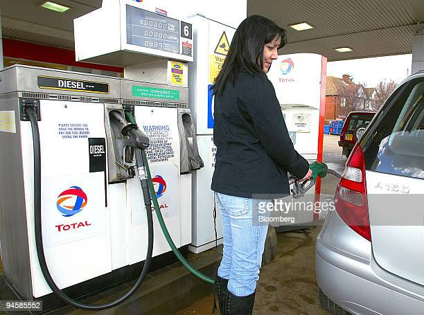 Dawn O'Loughlin fills her car with petrol in Louth Lincolnshire UK Monday March 19 2007 UK Chancellor of the Exchequer Gordon Brown will deliver what...