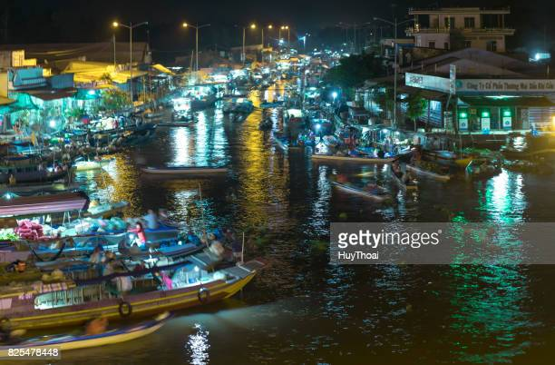 dawn on floating market with busy night boats lights twinkling transporting agricultural - floating market stock photos and pictures