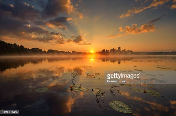 dawn on the monastery lake - lunin stock photos and pictures