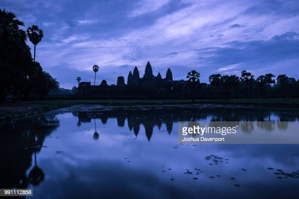 dawn over angkor wat - dawn davenport stock photos and pictures