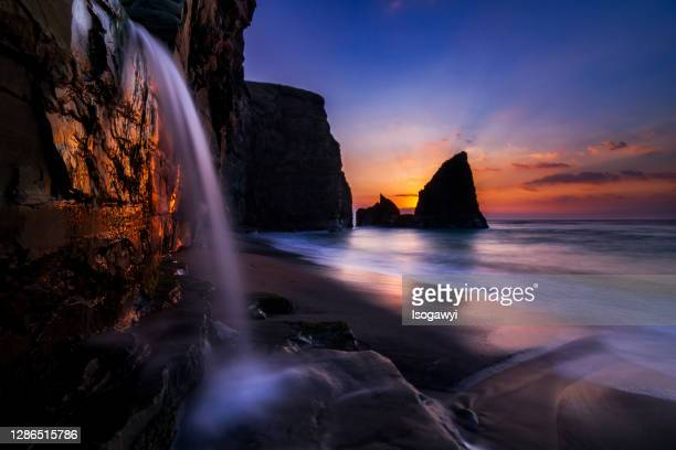 dawn over coastal waterfalls - isogawyi stock pictures, royalty-free photos & images