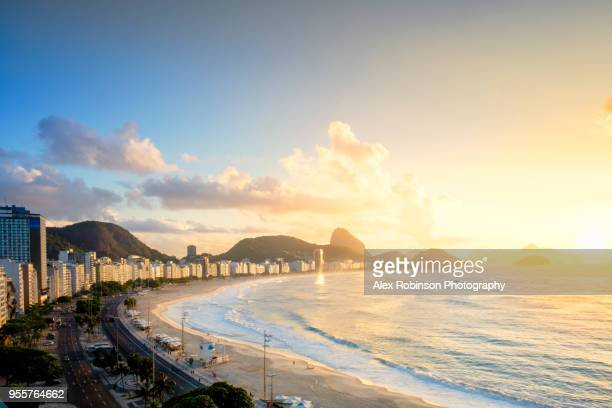 dawn over copacabana beach in rio de janeiro - copacabana beach stock pictures, royalty-free photos & images