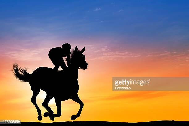 Dawn over Jockey riding a racehorse