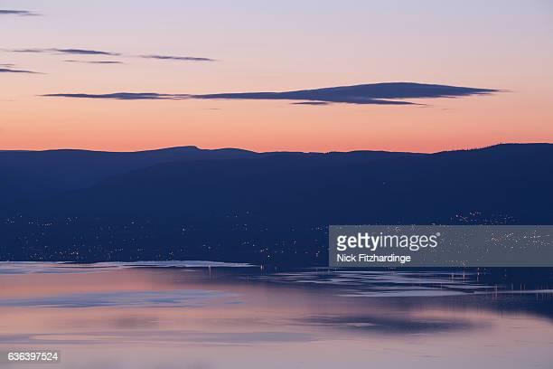 dawn over kelowna and okanagan lake from pincushion mountain, peachland, british columbia, canada - kelowna stock pictures, royalty-free photos & images