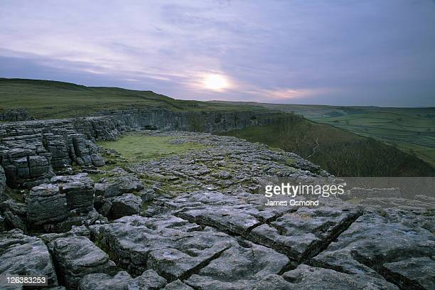 Dawn over limestone pavements above Malham Cove in the Yorkshire Dales National Park.