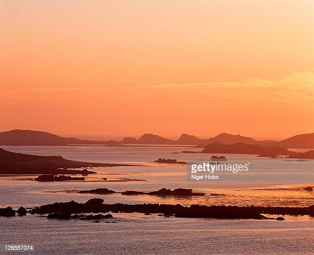 dawn over northern isles, seen from tresco - isles of scilly stock pictures, royalty-free photos & images
