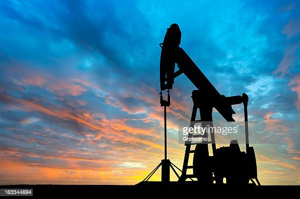 dawn over petroleum pump - texas stock pictures, royalty-free photos & images
