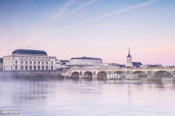 Dawn over the river Loire in the city of Saumur, France.