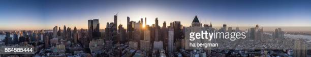 dawn panorama of manhattan - aerial shot - new york skyline stock photos and pictures