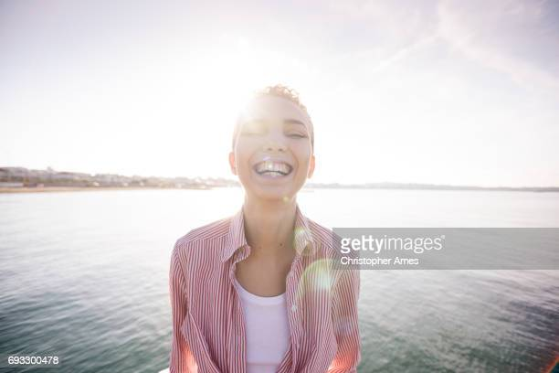Dawn Portrait of Happy Woman at the Ocean