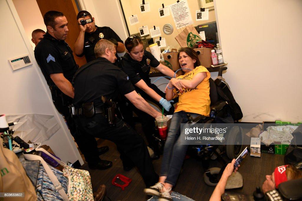 Protestors in Senator Cory Gardner's office get arrested after 58 hour sit-in. : News Photo