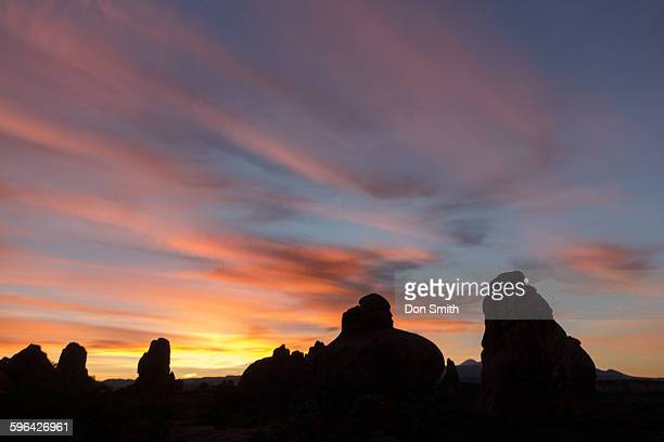 dawn sky over arches - don smith ストックフォトと画像