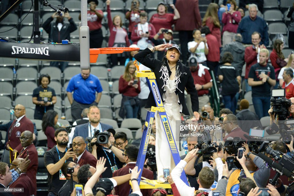 Dawn Staley head coach for South Carolina salutes fans after cutting down the net following their victory over Mississippi State during the 2017 Women's Final Four at American Airlines Center on April 2, 2017 in Dallas, Texas.