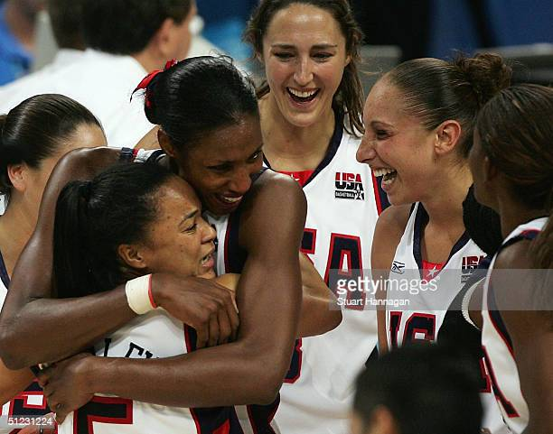 Dawn Staley Lisa Leslie Ruth Riley and Diana Taurasi of the United States celebrate winning the gold medal in the women's basketball gold medal match...