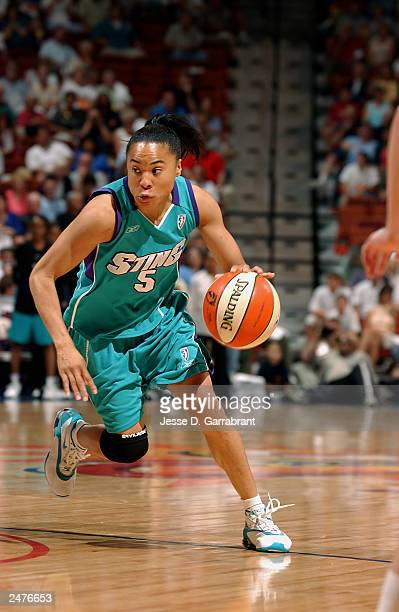 Dawn Staley of the Charlotte Sting drives upcourt during the game against the Connecticut Sun at Mohegan Sun Arena on August 22 2003 in Uncasville...