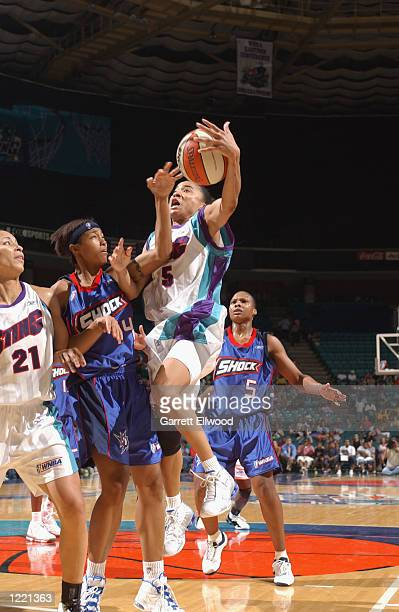 Dawn Staley of the Charlotte Sting gets the ball knocked away by Deanna Nolan of the Detroit Shock during the game on July 27 2002 at Charlotte...