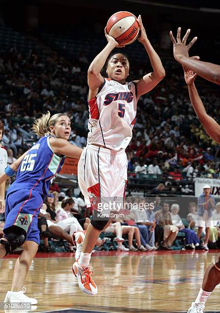 Dawn Staley of the Charlotte Sting shoots over Becky Hammon of the New York Liberty on July 20 2004 at the Charlotte Coliseum in Charlotte North...