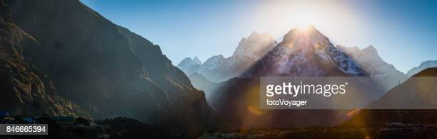 Dawn sunbeams over Himalaya mountain peaks panorama Sherpa village Nepal