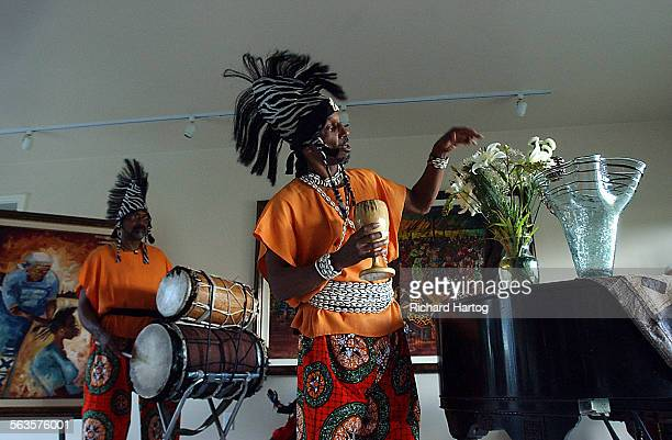Dawn Sutherland celebrates Kwanzaa with friends at her home Sunday afternoon in Baldwin Hills Her home is filled with African art and African...