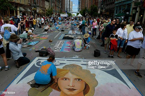 Dawn Wagner of Thousand Oaks CA works on a reproduction of 'Spring' originally by Alphonse Mucha during the Denver Chalk Art Festival on Larimer...