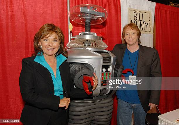 Dawn Wells and Billy Mumy pose with the robot from 'Lost in Space' as they attend day 1 of Motor City Comic Con 2012 at the Suburban Collection...