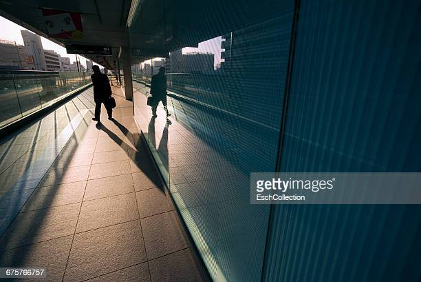 Dawn with businessman arriving in Osaka, Japan