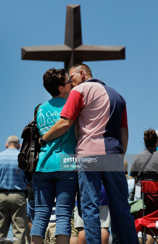 Dawna Middleton and Bill Cook share a moment together during a prayer service in front of the iron cross that is all that remains of St. Mary's church after it was destroyed by the tornado one year ago today on May 22, 2012 in Joplin, Missouri. The EF-5 tornado devastated the leaving behind a path of destruction along with 161 deaths and hundreds of injuries, but one year later there are signs that the town is beginning to recover.