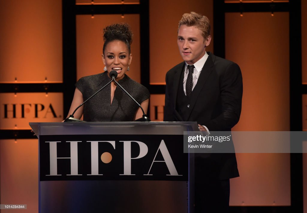 Dawn-Lyen Gardner (L) and Ben Hardy speak onstage during the Hollywood Foreign Press Association's Grants Banquet at The Beverly Hilton Hotel on August 9, 2018 in Beverly Hills, California.