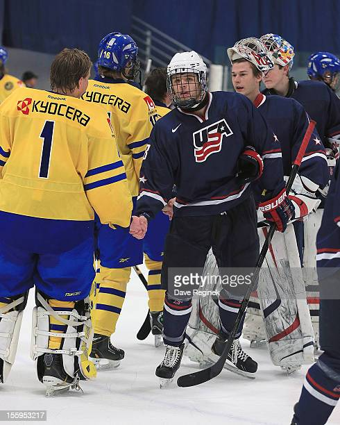 Dawson Cook of the USA shakes hands with goaltender Ebbe Sionas of Sweden after the game during the U-18 Four Nations Cup tournament on November 9,...