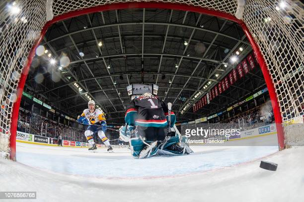 Dawson Davidson of the Saskatoon Blades scores the overtime winning goal on James Porter of the Kelowna Rockets at Prospera Place on December 1 2018...