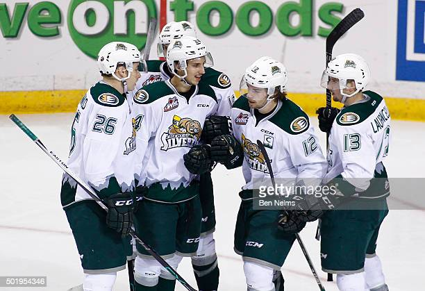 Dawson Leedahl of the Everett Silvertips celebrates his goal against the Vancouver Giants with teammates Cole MacDonald Lucas Skrumeda and Remi...