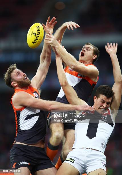 Dawson Simpson and Heath Shaw of the Giants competes for the ball against Rowan Marshall of the Saints during the round 19 AFL match between the...