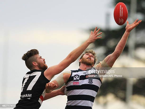 Dawson Simpson of Geelong and Jayden Bubb of Frankston compete in the air during the round 16 VFL match between Frankston and Geelong at Frankston...