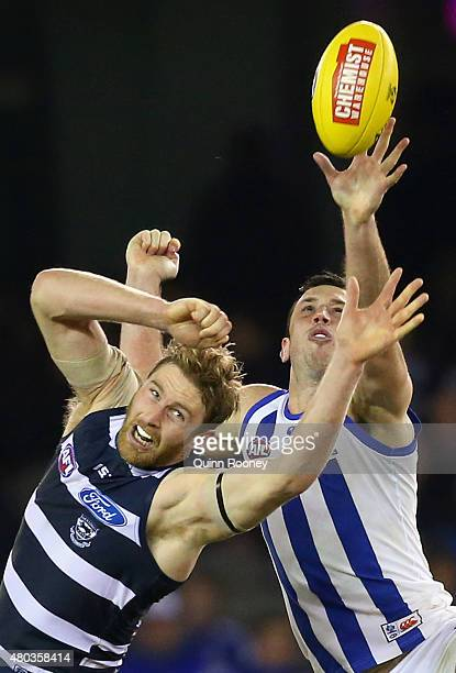 Dawson Simpson of the Cats and Todd Goldstein of the Kangaroos compete in the ruck during the round 15 AFL match between the North Melbourne...