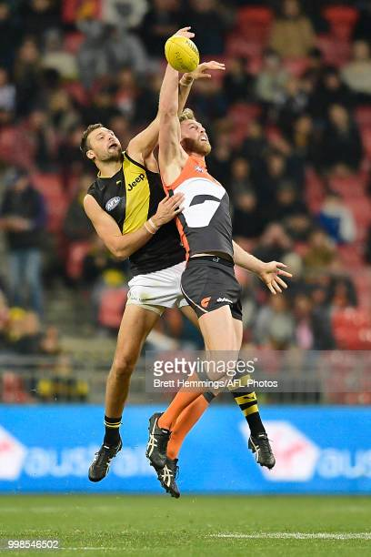 Dawson Simpson of the Giants and Toby Nankervis of the Tigers contest the ball during the round 17 AFL match between the Greater Western Sydney...
