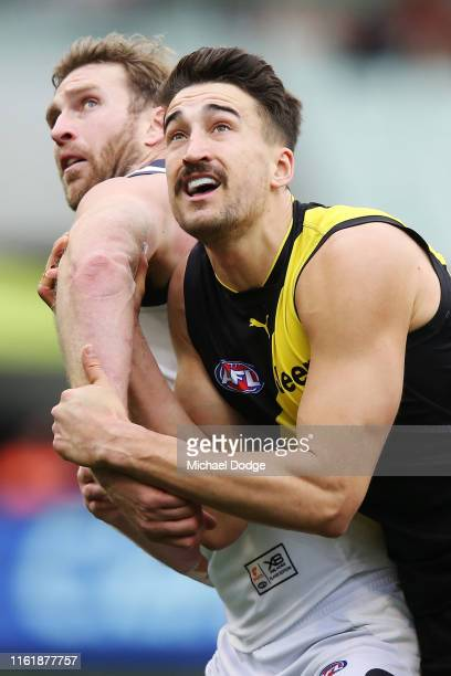 Dawson Simpson of the Giants competes for the ball against Ivan Soldo of the Tigers during the round 17 AFL between the Richmond Tigers and the...